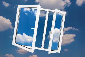 Window on sky background. Shining clean glasses contast with sky.