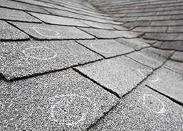 inspected roof with marked shingles