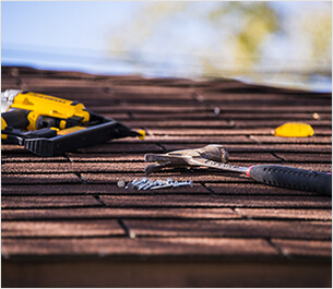 Tools on Roof - toledo roofing contractor