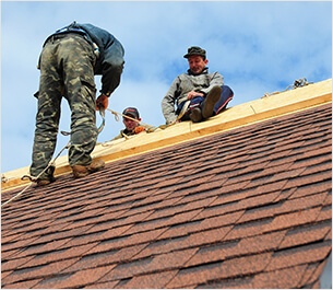 workers installing ridge cap