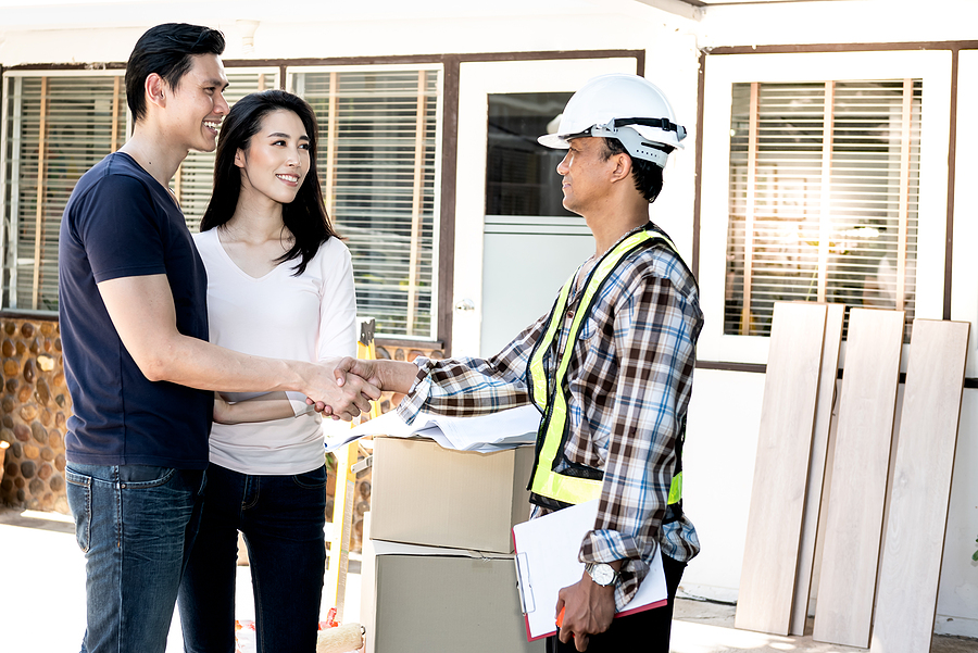 Homeowners talking with their home improvement renovation contractor.