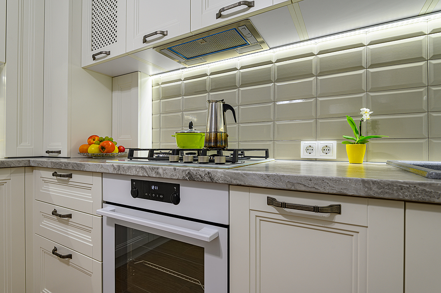 Cozy modern kitchen with great lighting and bright white tile backsplash.