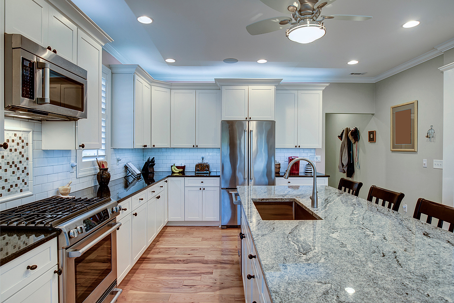 Nice kitchen recently remodeled with addition of large quartz island with bar stools for extra seating.