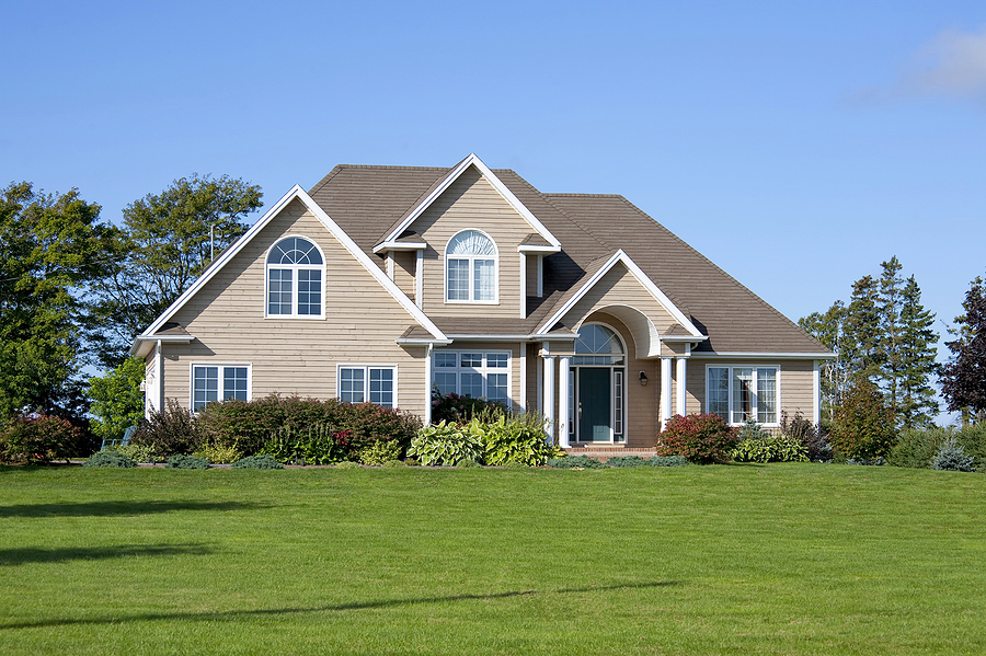 Exterior of a detached modern north American family home in a rural setting.