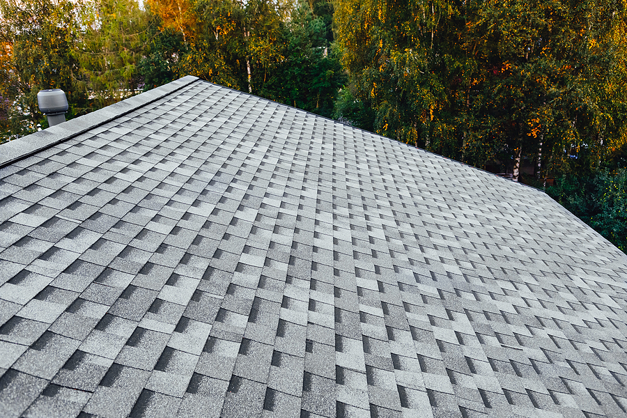 Family Home renovated roof or new roof with asphalt shingles.